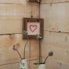 Motif en faïence et cadre en vieux bois